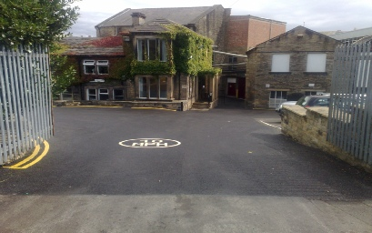 500 tonnes of surfacing replaced on this access road and car parks at  Stanningley